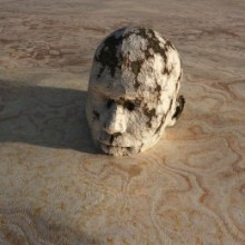 Man stuck in sand up to his head